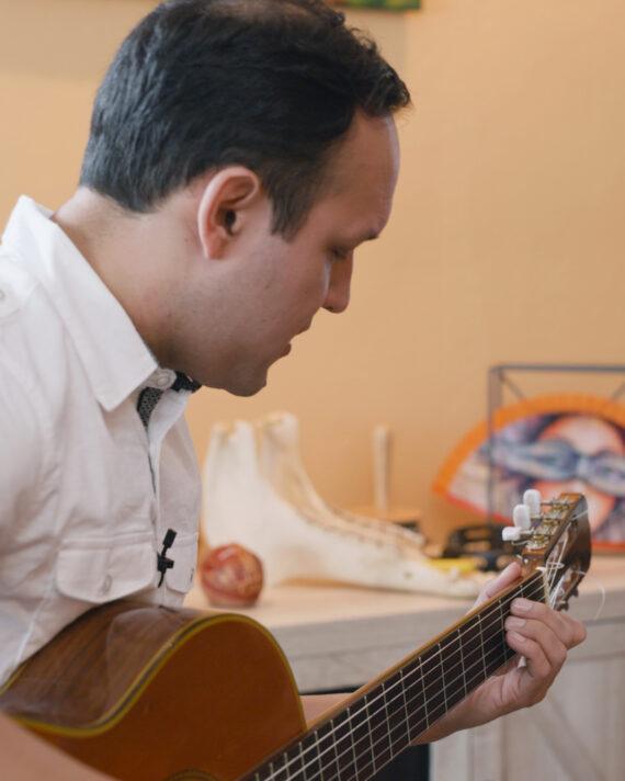 Richard playing guitar
