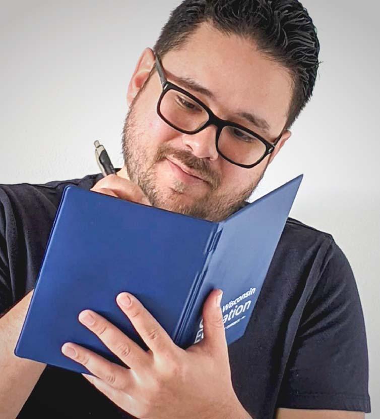 Scientist logging data in a log book