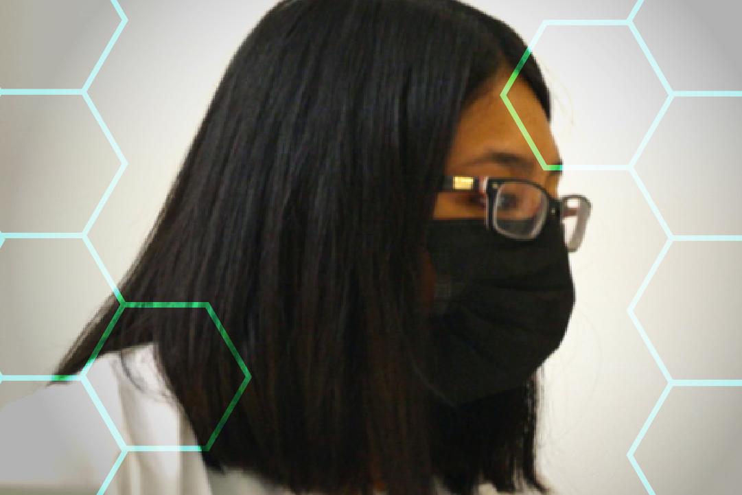 Scientist working in lab wearing white lab coat